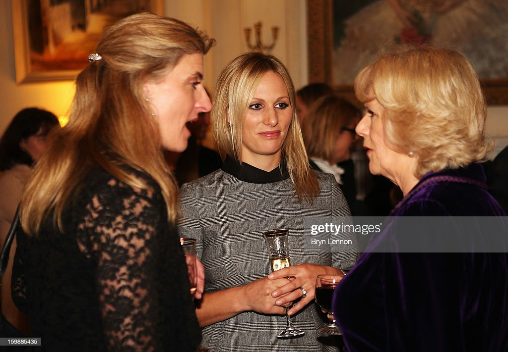 <a gi-track='captionPersonalityLinkClicked' href=/galleries/search?phrase=Camilla+-+Duchess+of+Cornwall&family=editorial&specificpeople=158157 ng-click='$event.stopPropagation()'>Camilla</a>, Duchess of Cornwall (R) chats to Olympic Eventer <a gi-track='captionPersonalityLinkClicked' href=/galleries/search?phrase=Zara+Phillips&family=editorial&specificpeople=161323 ng-click='$event.stopPropagation()'>Zara Phillips</a> (C) during a reception hosted by the Duchess of Cornwall for the British Equestrian Teams from the London 2012 Olympics And Paralympics at Clarence House on January 22, 2013 in London, England.
