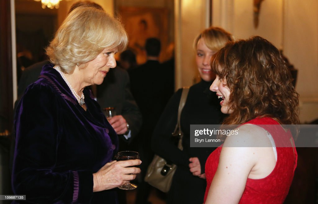 <a gi-track='captionPersonalityLinkClicked' href=/galleries/search?phrase=Camilla+-+Duchess+of+Cornwall&family=editorial&specificpeople=158157 ng-click='$event.stopPropagation()'>Camilla</a>, Duchess of Cornwall chats to Para-Equestrian Dressage rider Natasha Baker during a reception hosted by the Duchess of Cornwall for the British Equestrian Teams from the London 2012 Olympics And Paralympics at Clarence House on January 22, 2013 in London, England.