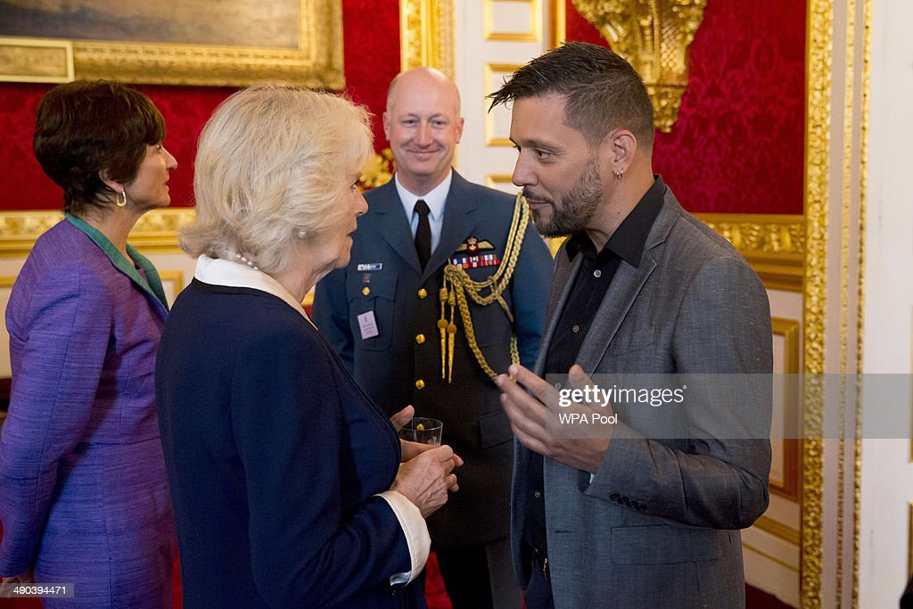 <a gi-track='captionPersonalityLinkClicked' href=/galleries/search?phrase=Camilla+-+Hertiginna+av+Cornwall&family=editorial&specificpeople=158157 ng-click='$event.stopPropagation()'>Camilla</a>, Duchess of Cornwall chats with Canadian television host for CBC <a gi-track='captionPersonalityLinkClicked' href=/galleries/search?phrase=George+Stroumboulopoulos&family=editorial&specificpeople=4334058 ng-click='$event.stopPropagation()'>George Stroumboulopoulos</a> during a reception for Canadians living and working in the UK at St James's Palace on May 14, 2014 in London, United Kingdom. Prince Charles and his wife <a gi-track='captionPersonalityLinkClicked' href=/galleries/search?phrase=Camilla+-+Hertiginna+av+Cornwall&family=editorial&specificpeople=158157 ng-click='$event.stopPropagation()'>Camilla</a> the Duchess of Cornwall are due to visit Canada from May 18-21, where they will attend events for Victoria Day, the centenary of World War I and the 150th anniversary of the Charlottetown Conference that led to Canadian Confederation.