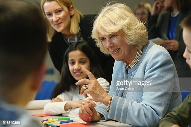 Camilla Duchess of Cornwall chats with children at the UNICEF center on March 18 2016 in Podgorica Montenegro The Prince and Duchess are visiting...