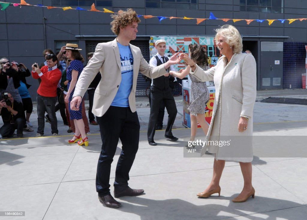Camilla (centre R), Duchess of Cornwall dances with a student volunteer during a rock n roll dance display in Christchurch on November 16, 2012. Britain's Prince Charles and his wife Camilla are on the last leg of a tour to mark Queen Elizabeth II's diamond jubilee which has also included Papua New Guinea and Australia and ends on November 16. AFP PHOTO / POOL / Ross Setford