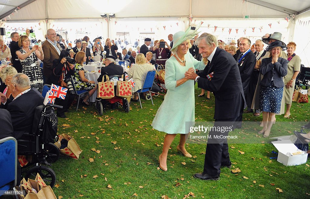 Camilla, Duchess of Cornwall dances with Royal Navy Veteran Jim Booth aged 94 from Taunton, Somerset during the 70th Anniversary commemorations of VJ Day (Victory over Japan) at the Royal British Legion reception in the College Gardens of Westminster Abbey on August 15, 2015 in London, England. The event marks the 70thanniversary of the surrender of Japanese Forces, bringing about the end of World War II. Queen Elizabeth II and Prince Philip, Duke of Edinburgh will join British Prime Minister David Cameron and former prisoners of war during services throughout the day as tributes are made to the the estimated 71,244 British and Commonwealth casualties of the Far East conflict. Japan formally surrendered on September 2, 1945 at a ceremony in Tokyo Bay on USS Missouri