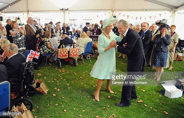 Camilla Duchess of Cornwall dances with Royal Navy Veteran Jim Booth aged 94 from Taunton Somerset during the 70th Anniversary commemorations of VJ...