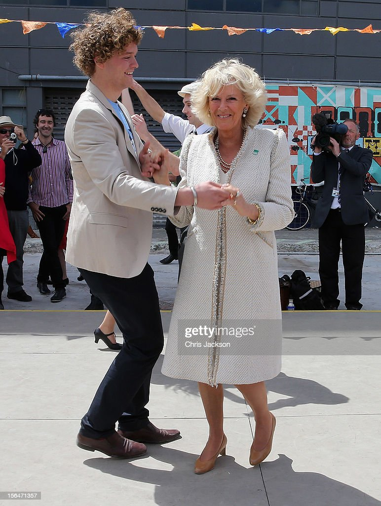 Camilla, Duchess of Cornwall dances with Sam Johnson at the Dance-O-Mat during a visit to Christchurch on November 16, 2012 in Feilding, New Zealand. The Dance-O-Mat was set up to give people the opportunity to keep dancing after many of the venues were destroyed by the earthquake of 2010. The Royal couple are in New Zealand on the last leg of a Diamond Jubilee that takes in Papua New Guinea, Australia and New Zealand.