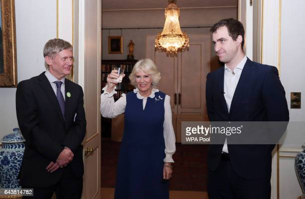 Camilla Duchess of Cornwall delivers a toast as she attends a reception to launch The Great Get Together at Clarence House alongside Peter Stewart...