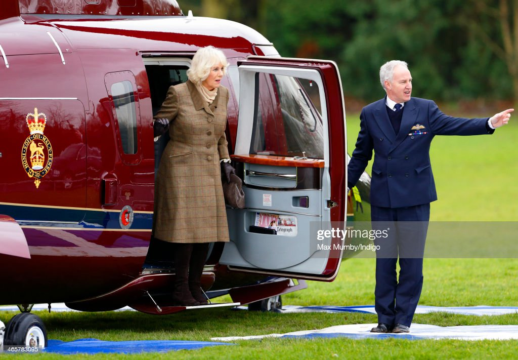 Camilla, Duchess of Cornwall disembarks a Sikorsky Helicopter (The Queen's Helicopter Flight) as she and Prince Charles, Prince of Wales arrive for a visit to The Bell pub during a day of engagements in Essex on January 29, 2014 in Purleigh, England.