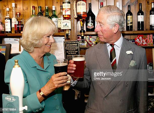 Camilla Duchess of Cornwall enjoys a pint of 'Tricky Whu' while the Prince of Wales enjoys a pint of 'Prince of Pales' during a visit to the...