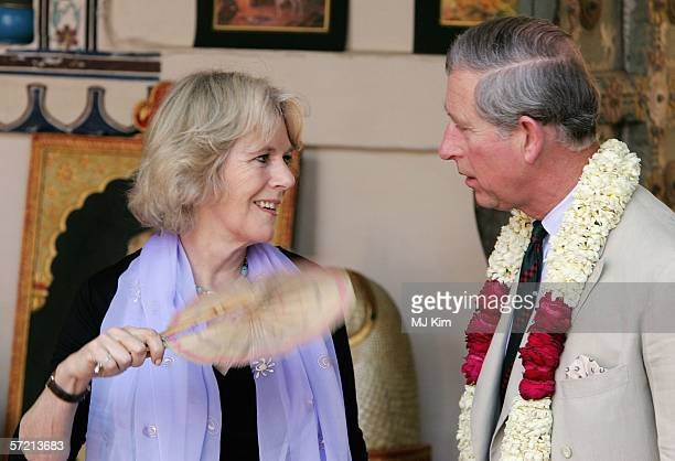 Camilla Duchess of Cornwall fans her husband Prince Charles Prince of Wales during their visit to the arts and craft market at the Jodhpur fort on...