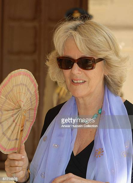 Camilla Duchess of Cornwall fans herself in the heat as she visits the arts and craft market at the Jodhpur fort on the eleventh day of a 12 day...