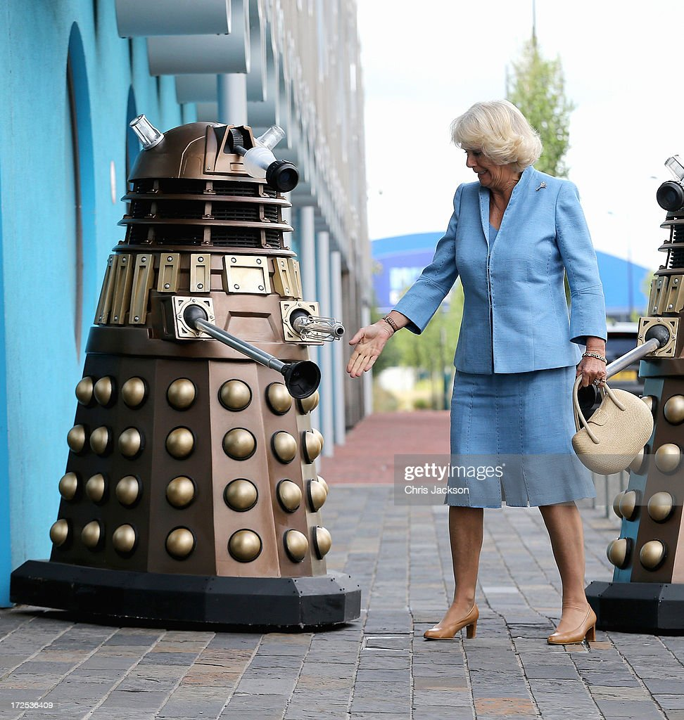 Camilla, Duchess of Cornwall greets a Dalek as she visits BBC Roath Lock Studios on July 3, 2013 in Cardiff, Wales.