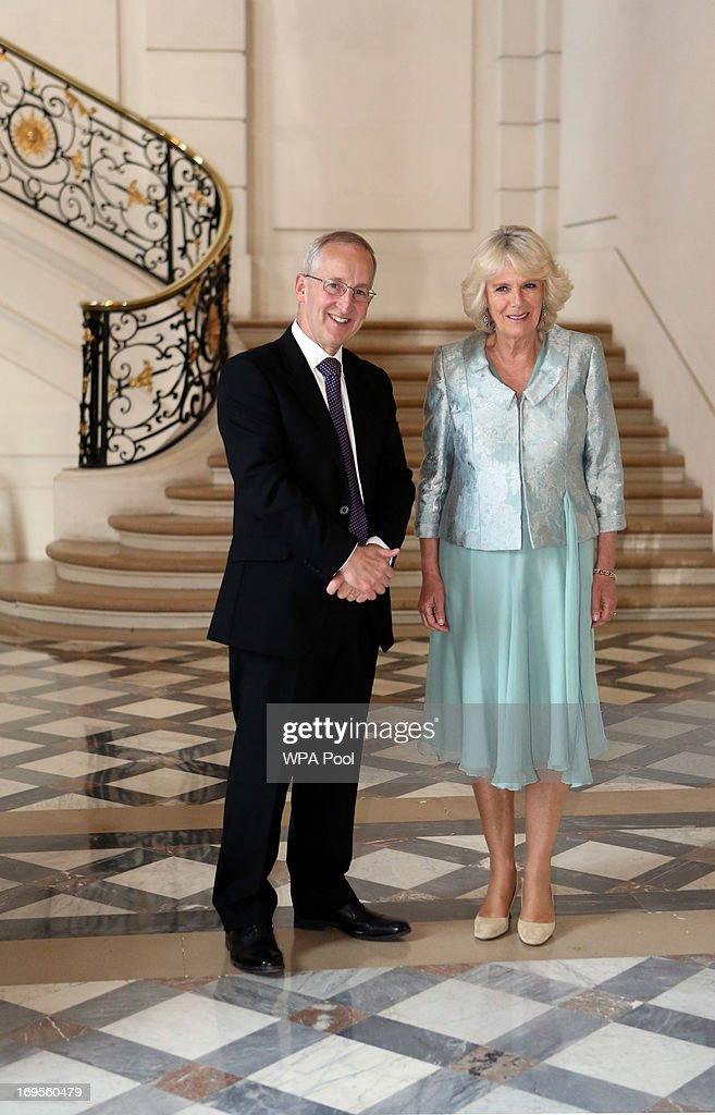 <a gi-track='captionPersonalityLinkClicked' href=/galleries/search?phrase=Camilla+-+Duchess+of+Cornwall&family=editorial&specificpeople=158157 ng-click='$event.stopPropagation()'>Camilla</a>, Duchess of Cornwall greets Ambassador Sir Peter Ricketts as she arrives at a reception at the British Embassy on May 27, 2013 in Paris, France. The Duchess of Cornwall is on her first overseas solo engagement in Paris in support of the homeless charity EMMAUS, of which she is patron.