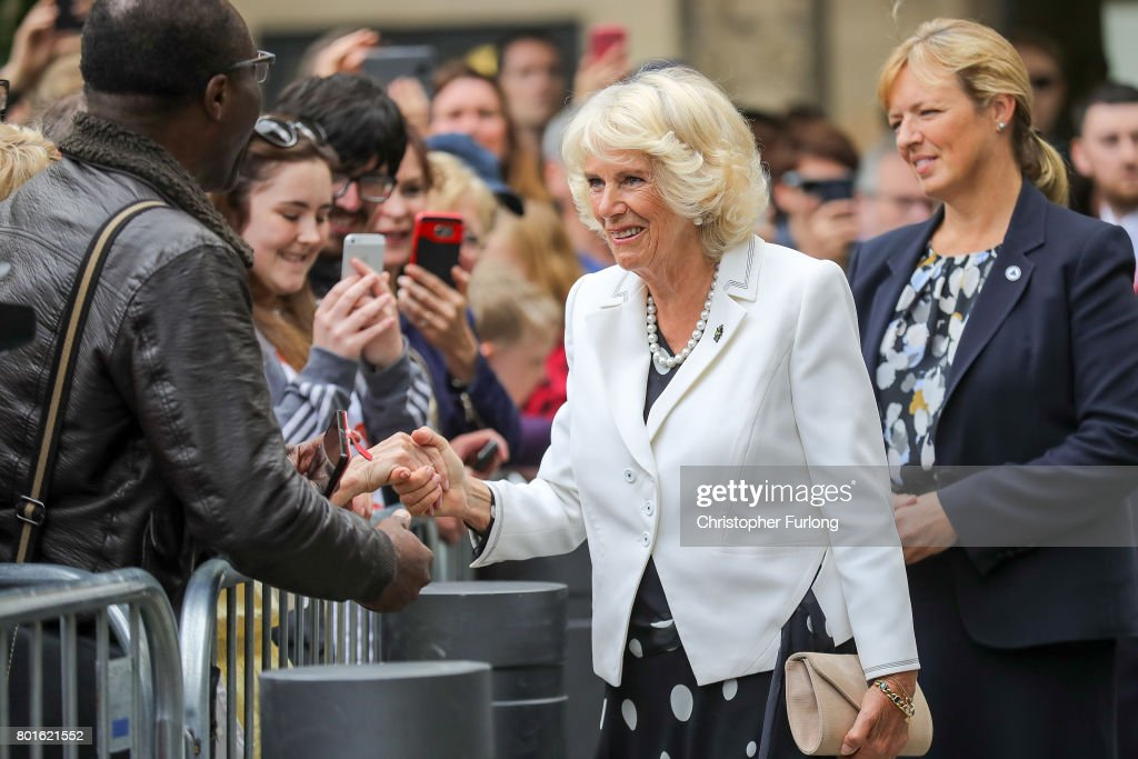 Camilla, Duchess of Cornwall greets members of the public before a reception in Manchester Town Hall to thank those involved during the Manchester Attack on June 26, 2017 in Manchester, England. Earlier in the day the Prince of Wales and the Duchess visited the scene of the suicide attack at the Manchester Arena. During their visit they both wore a Worker Bee badge, the symbol of the City of Manchester, which has now taken on more credence by people as asign of resilience.