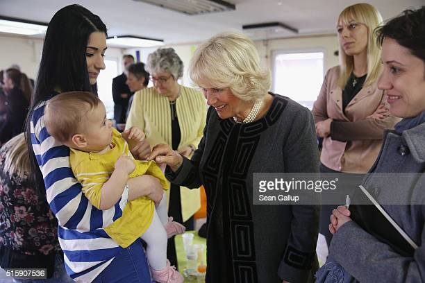 Camilla Duchess of Cornwall greets mothers and children during her visit to the Novak Djokovic Foundation on March 16 2016 in Belgrade Serbia The...