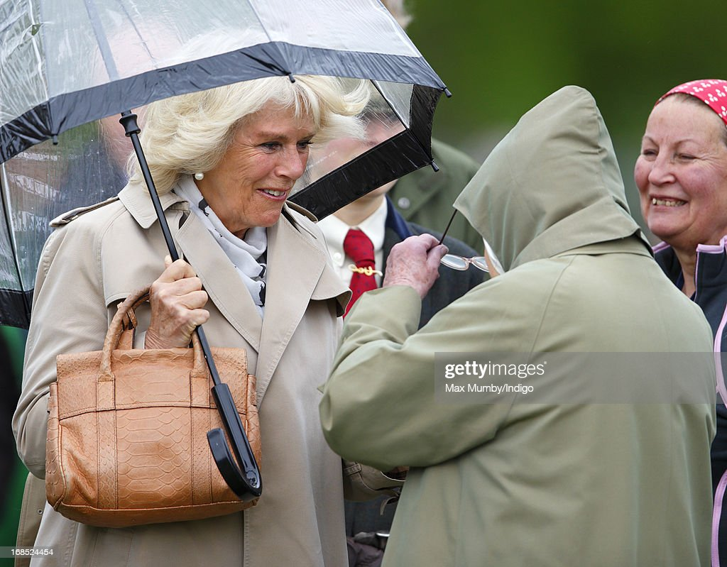 Camilla, Duchess of Cornwall greets Queen Elizabeth II before watching one of Queen Elizabeth's horses compete in the Highland class on day 3 of the Royal Windsor Horse Show on May 10, 2013 in Windsor, England.