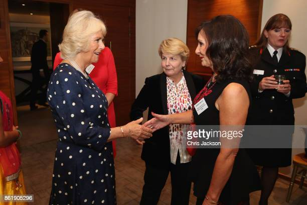 Camilla Duchess of Cornwall greets Shirley Ballas at the annual Women of the Year lunch at Intercontinental Hotel on October 16 2017 in London England