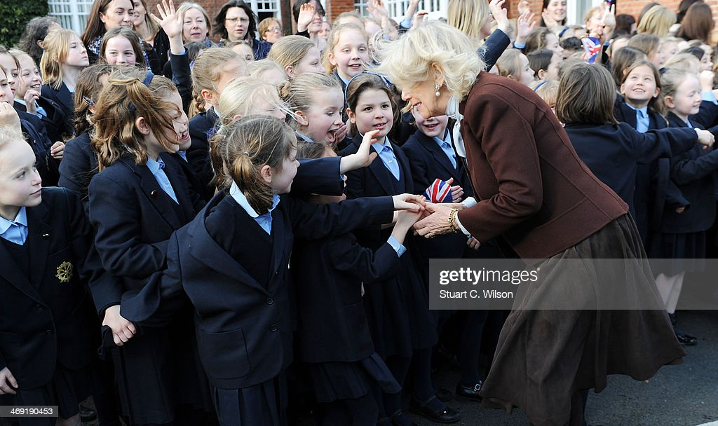 Camilla, Duchess Of Cornwall greets young girls as he visits St Catherine's School in Bramley, Surrey on February 13, 2014 in Guildford, England.