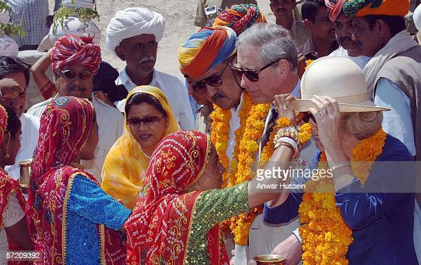 Camilla Duchess of Cornwall has a tilak mark put on her forehead at the village of Artiya on the tenth day of their 12 day official tour visiting...