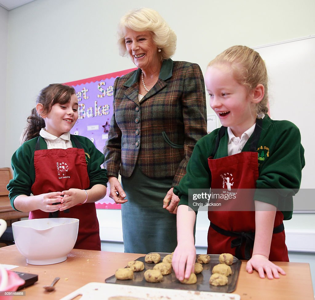 <a gi-track='captionPersonalityLinkClicked' href=/galleries/search?phrase=Camilla+-+Duchess+of+Cornwall&family=editorial&specificpeople=158157 ng-click='$event.stopPropagation()'>Camilla</a>, Duchess of Cornwall helps make chocolate chip cookies as she visits a cookery class at Forest and Sandridge Church of England Primary School during an away day to Wiltshire on February 9, 2016 in Melksham, England. The Duchess officially opened the new school building during her visit.