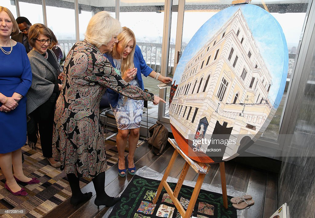 <a gi-track='captionPersonalityLinkClicked' href=/galleries/search?phrase=Camilla+-+Duchess+of+Cornwall&family=editorial&specificpeople=158157 ng-click='$event.stopPropagation()'>Camilla</a>, Duchess of Cornwall helps put the finishing touches to NZL artist Mandii Pope's Maori-themed painting of Clarence House as they celebrate success of New Zealand women in the UK on Waitangi day at New Zealand House on February 6, 2014 in London, England. Waitangi Day commemorates the signing of a treaty between 500 Maori Chiefs and the British Crown in 1840.