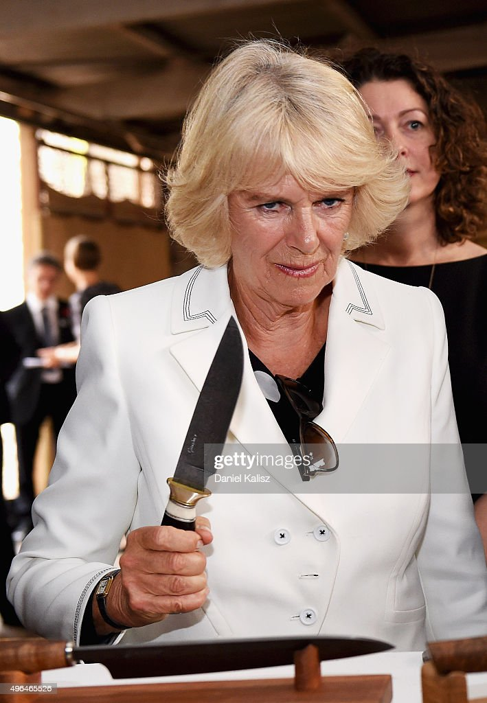 Camilla, Duchess of Cornwall holds a knife as she visit's Seppeltsfield Winery on November 10, 2015 in Barossa Valley, Australia. The Royal couple are on a 12-day tour visiting seven regions in New Zealand and three states and one territory in Australia.