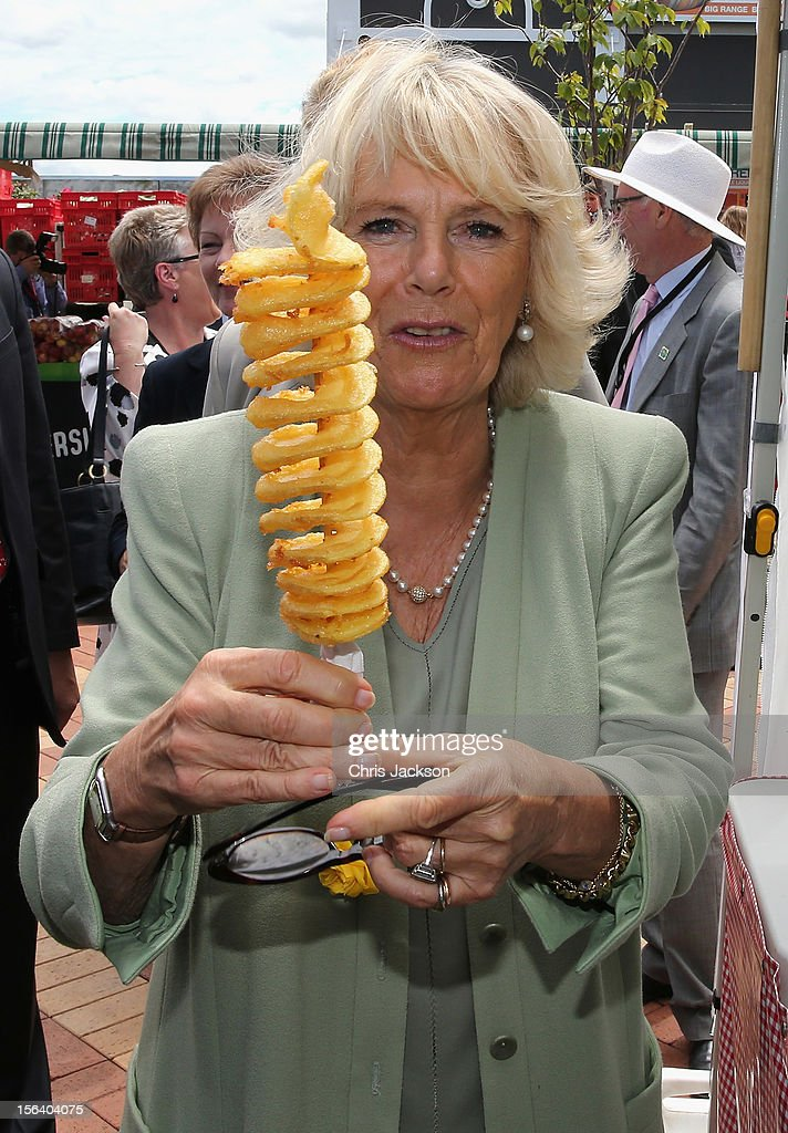 Camilla, Duchess of Cornwall holds up a potato 'twirl' as she tours a farmers market on November 15, 2012 in Feilding, New Zealand. The Royal couple are in New Zealand on the last leg of a Diamond Jubilee that takes in Papua New Guinea, Australia and New Zealand.