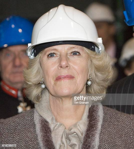 Camilla Duchess of Cornwall in builders hard hat tours Gorton Monastery to see the work being done by students and craftsmen to restore the landmark...