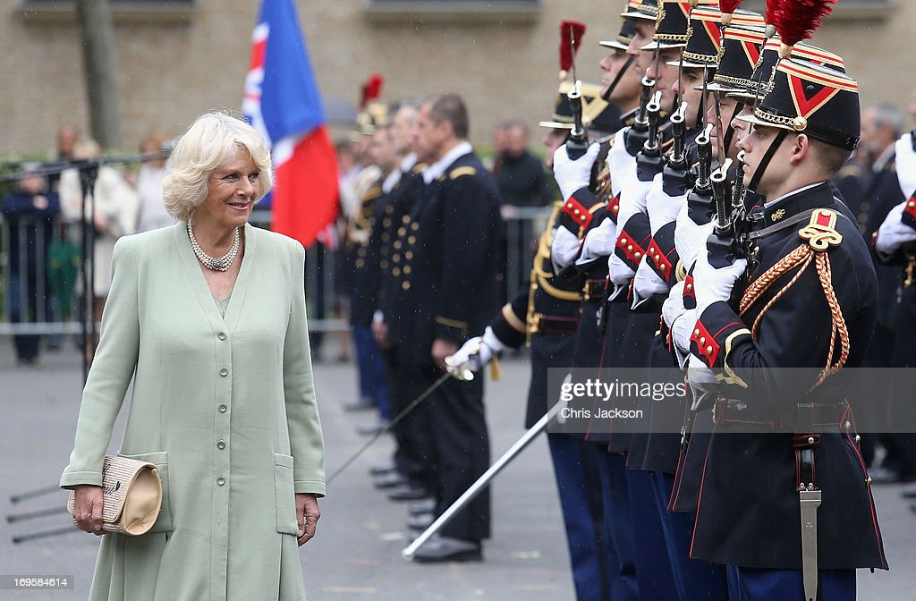Camilla, Duchess of Cornwall inspects an honour guard at the French Republican Guard headquarters on May 28, 2013 in Paris France. Camilla is on her first overseas solo engagement for a two day visit to Paris in support of the homeless charity EMMAUS of which she is patron.