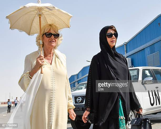 Camilla Duchess of Cornwall is accompanied by Reem alHashemi UAE Minister of State on her visit to the Dubai Humanitarian International City during...