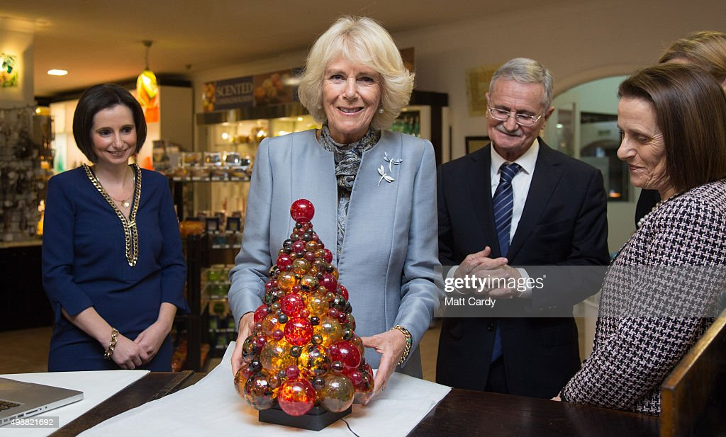 Camilla, Duchess of Cornwall is presented with a glass Christmas tree on a visit to Mdina Glass, in Ta' Qali on November 26, 2015 near Valletta, Malta. Queen Elizabeth II, The Duke of Edinburgh, Prince Charles, Prince of Wales and Camilla, Duchess of Cornwall arrived today to attend the Commonwealth Heads of State Summit.
