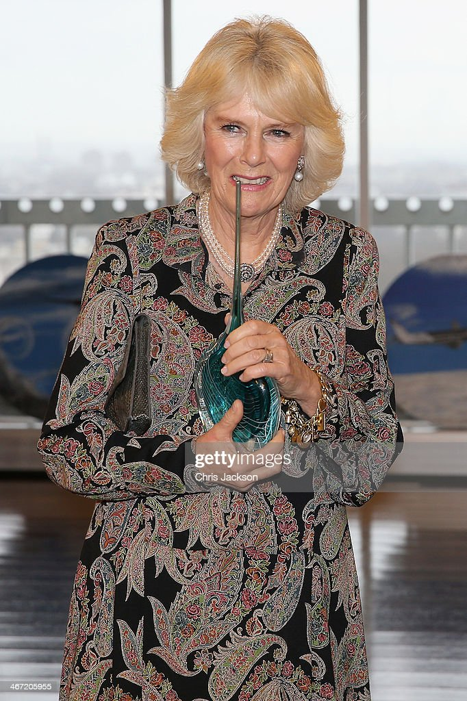 <a gi-track='captionPersonalityLinkClicked' href=/galleries/search?phrase=Camilla+-+Duchess+of+Cornwall&family=editorial&specificpeople=158157 ng-click='$event.stopPropagation()'>Camilla</a>, Duchess of Cornwall is presented with a glass sculpture as she helps celebrate success of New Zealand women in the UK on Waitangi day at New Zealand House on February 6, 2014 in London, England. Waitangi Day commemorates the signing of a treaty between 500 Maori Chiefs and the British Crown in 1840.