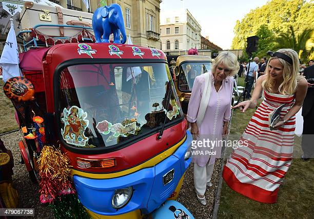 Camilla Duchess of Cornwall is shown a rickshaw designed by her sister Annabel Elliot and Luke Irwin at a 'Travels To My Elephant' Royal Richshaw...
