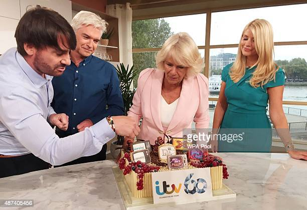 Camilla Duchess of Cornwall is shown an ITV birthday cake as she meets This Morning host Philip Schofield and copresenter Holly Willoughby during a...