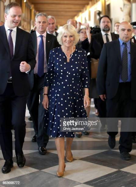 Camilla Duchess Of Cornwall is shown around by Dr Eike Schmidt director of the Uffuzi Gallery during a visit to the Vasari Corridor on day three of...