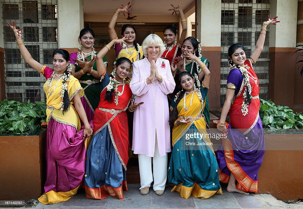 <a gi-track='captionPersonalityLinkClicked' href=/galleries/search?phrase=Camilla+-+Duchess+of+Cornwall&family=editorial&specificpeople=158157 ng-click='$event.stopPropagation()'>Camilla</a>, Duchess of Cornwall is shown some Indian dance moves by girls from Asha Sadan (House of Hope) for children who have been abandoned or abused during day 4 of an official visit to India on November 9, 2013 in Mumbai, India. This will be the Royal couple's third official visit to India together and their most extensive yet, which will see them spending nine days in India and afterwards visiting Sri Lanka in order to attend the 2013 Commonwealth Heads of Government Meeting.