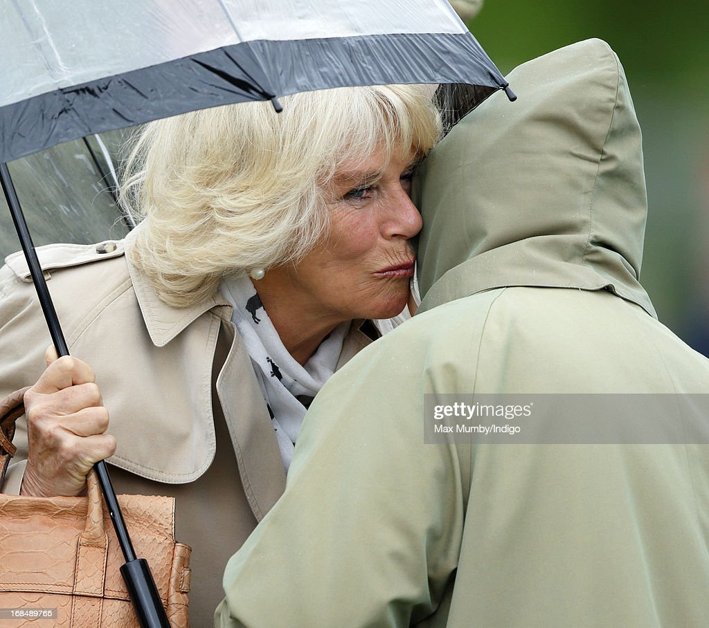 Camilla, Duchess of Cornwall kisses Queen Elizabeth II before watching one of Queen Elizabeth's horses compete in the Highland class on day 3 of the Royal Windsor Horse Show on May 10, 2013 in Windsor, England.