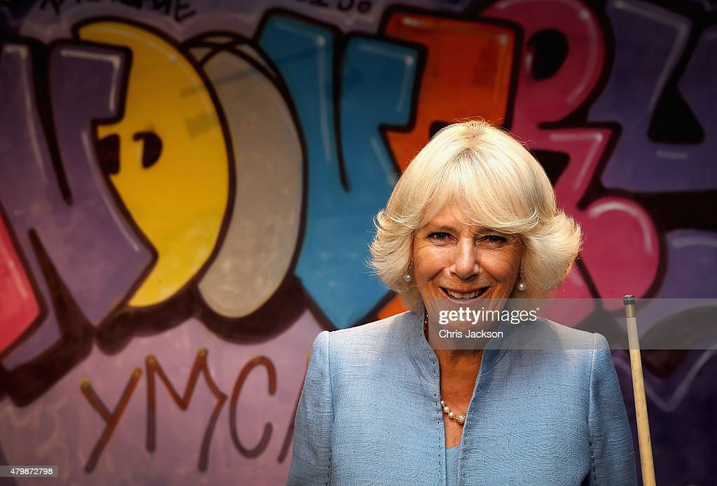 Camilla, Duchess of Cornwall laughs as she visits the Llandovery YMCA on July 8 2015 in Llandovery, Wales. Llandovery YMCA was founded in 1990 to provide a safe meeting place for the young people of the town and surrounding villages.