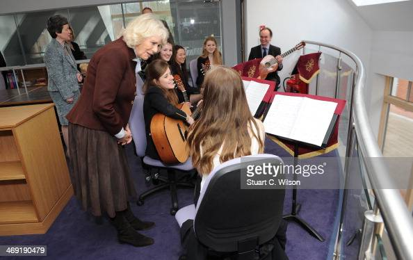 Camilla Duchess Of Cornwall listens to girls play music as she visits St Catherine's School in Bramley Surrey on February 13 2014 in Guildford England