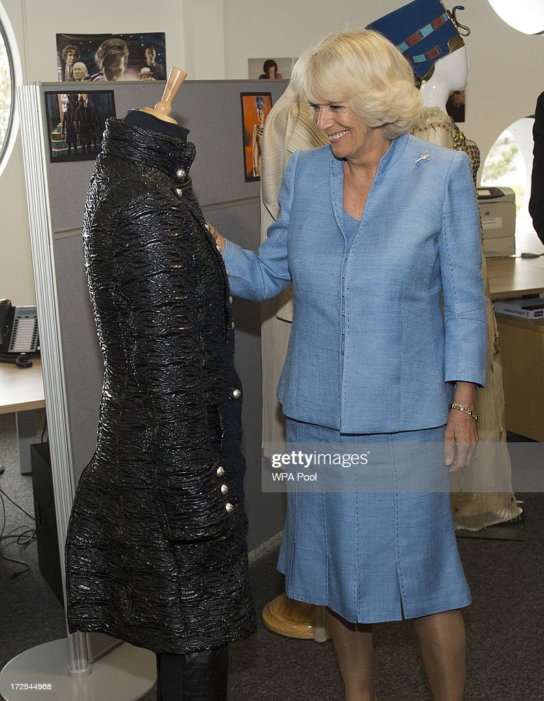 <a gi-track='captionPersonalityLinkClicked' href=/galleries/search?phrase=Camilla+-+Duchess+of+Cornwall&family=editorial&specificpeople=158157 ng-click='$event.stopPropagation()'>Camilla</a>, Duchess of Cornwall looks at a costume during their visit to the set of the BBC One drama series 'Doctor Who' at BBC Roath Lock Studios on July 3, 2013 in Cardiff, Wales.