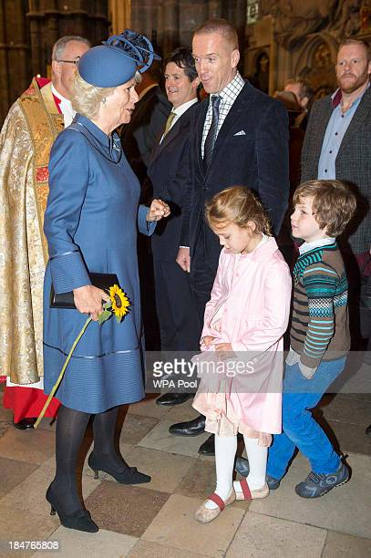 Camilla Duchess of Cornwall meets actor Damien Lewis and his children Manon and Gulliver as they attend the British Food Fortnight's harvest festival...