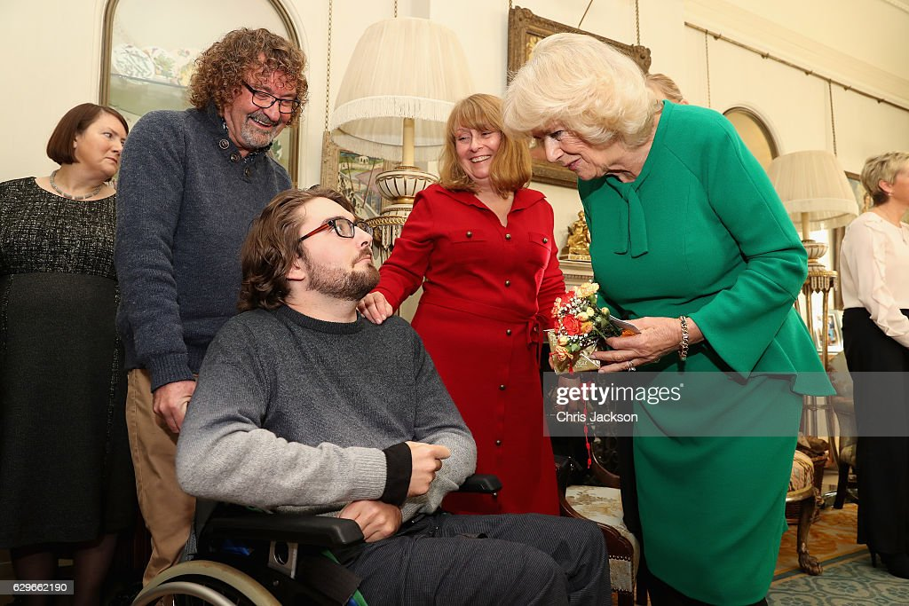 Camilla, Duchess of Cornwall meets children from Helen and Douglas House during a reception at Clarence House on December 14, 2016 in London, England. The Duchess of Cornwall, Patron, Helen & Douglas House invited children from the charity and children supported by Roald Dahl's Marvellous Children's Charity to decorate the Christmas tree and join Her Royal Highness for lunch at Clarence House.