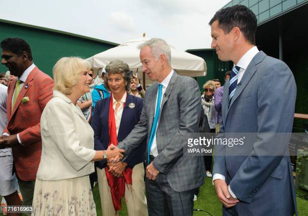 Camilla Duchess of Cornwall meets former tennis players Virginia Wade John McEnroe and Tim Henman during day four of the Wimbledon Lawn Tennis...