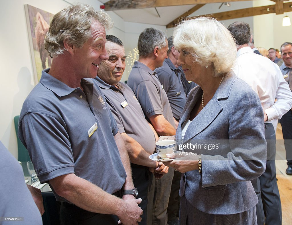 Camilla, Duchess of Cornwall meets Gareth Williams, owner of the working dog Dot as she tours the Farm Shop during a visit to Rhug Estate Farm on July 2, 2013 in Corwen, Denbighshire, Wales, United Kingdom. Rhug Estate farm shop first opened its doors in 2002 selling its own award-winning organic meat from a roadside takeaway and butchery. In December 2011, the newly built Rhug Estate farm shop was opened to the public with an enhanced butchery & delicatessen and a range of over 2,000 carefully selected products.