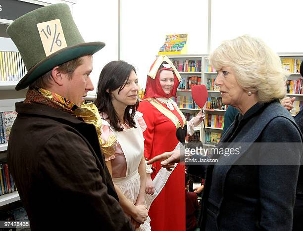 Camilla Duchess of Cornwall meets Katherine Kingsford Tom Walker and Marieke Van Hoof during a visit to a Mad Hatter's Tea Party at Foyles Westfield...