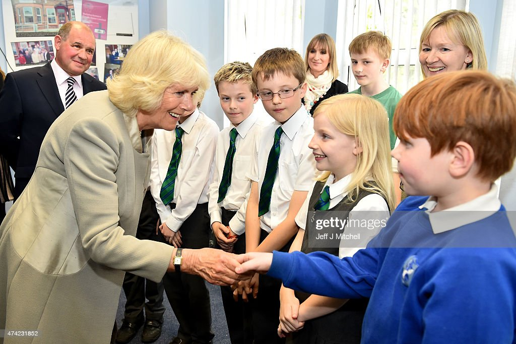 Camilla, Duchess of Cornwall meets school children as she visits Ballyhackamore Credit Union on May 21, 2015 in Belfast, Northern Ireland. Prince Charles, Prince of Wales and Camilla, Duchess of Cornwall will attend a series of engagements in Northern Ireland following their two day visit in the Republic of Ireland.