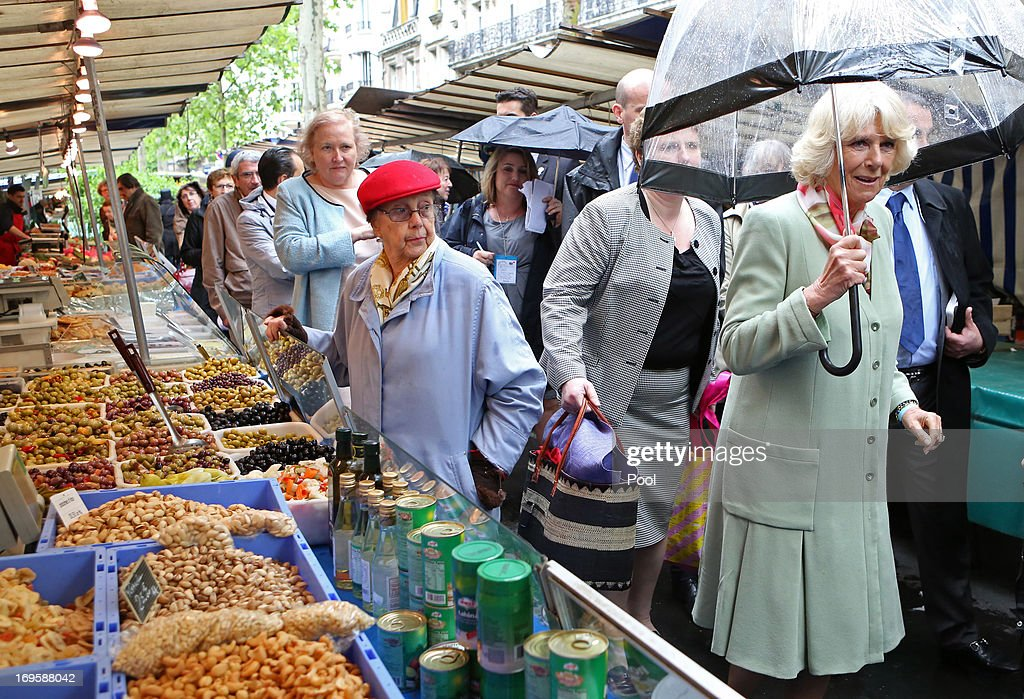 <a gi-track='captionPersonalityLinkClicked' href=/galleries/search?phrase=Camilla+-+Duchess+of+Cornwall&family=editorial&specificpeople=158157 ng-click='$event.stopPropagation()'>Camilla</a>, Duchess of Cornwall meets traders during a visit to Marche Raspil along the Boulevard Raspail on May 28, 2013 in Paris France. <a gi-track='captionPersonalityLinkClicked' href=/galleries/search?phrase=Camilla+-+Duchess+of+Cornwall&family=editorial&specificpeople=158157 ng-click='$event.stopPropagation()'>Camilla</a> is on her first overseas solo engagement for a two day visit to Paris in support of the homeless charity EMMAUS of which she is patron.