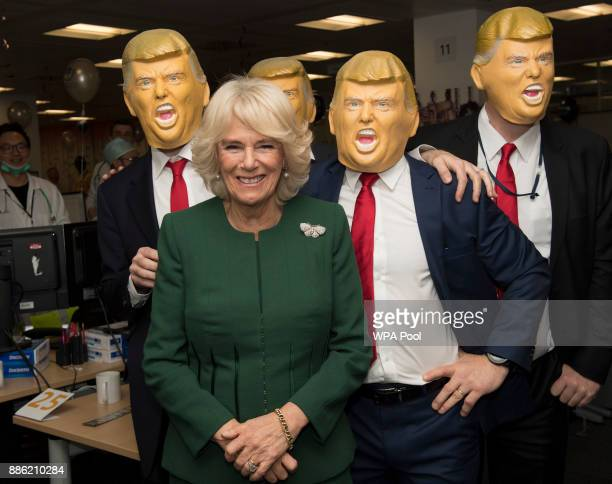 Camilla Duchess of Cornwall Patron Medical Detection Dogs meets staff and charity representatives dressed as Donald Trump during her visit to ICAP...