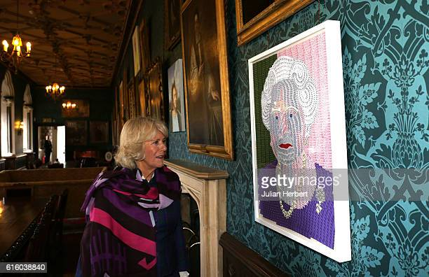 Camilla Duchess of Cornwall patron of Beanstalk looks at an art work called Reconciliation as she is shown around The Long Gallery by The Rt Revd...