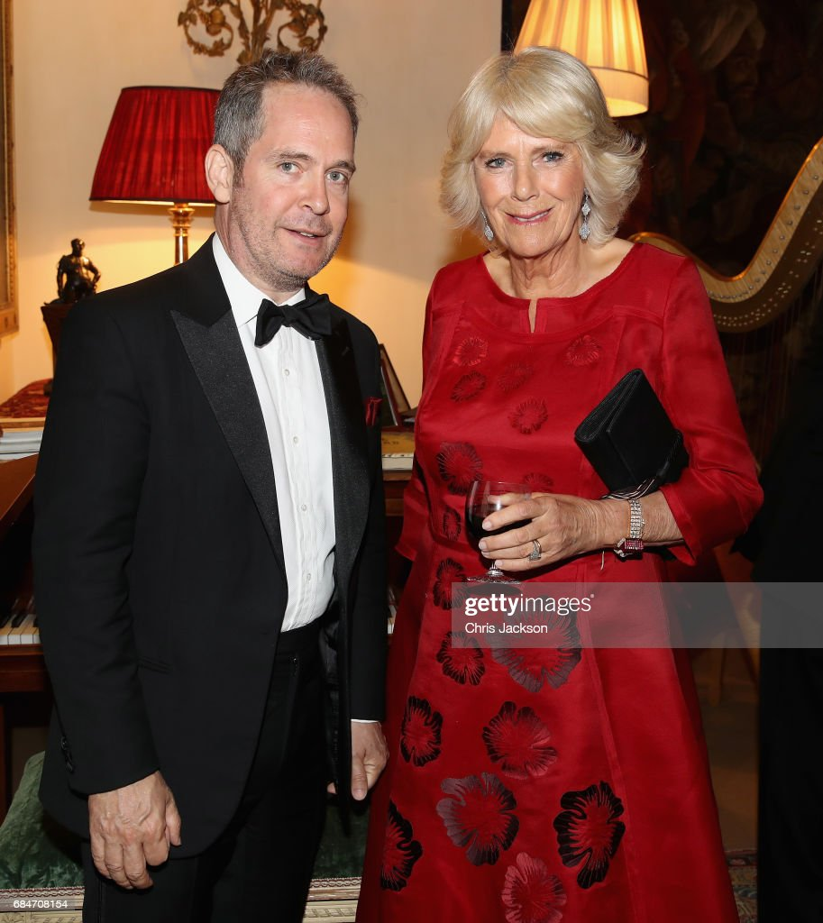 Camilla, Duchess of Cornwall, Patron of the London Library, poses with actor Tom Hollander as she hosts a dinner and evening of readings in honour of the Library's President, Sir Tom Stoppard at Clarence House on May 18, 2017 in London, England.