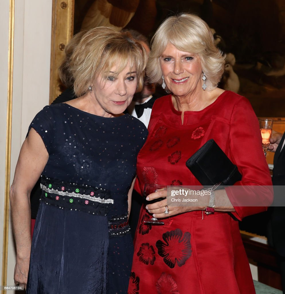Camilla, Duchess of Cornwall, Patron of the London Library, with Zoë Wanamaker, as she hosts a dinner and evening of readings in honour of the Library's President, Sir Tom Stoppard at Clarence House on May 18, 2017 in London, England.