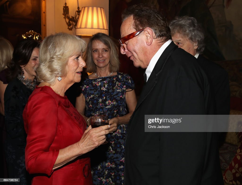 Camilla, Duchess of Cornwall, Patron of the London Library,chats with Maurice Saatchi as she hosts a dinner and evening of readings in honour of the Library's President, Sir Tom Stoppard at Clarence House on May 18, 2017 in London, England.